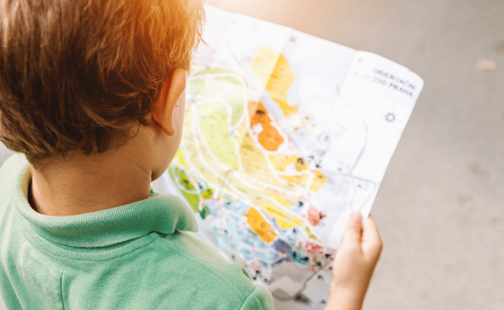 Preschool student looking at map