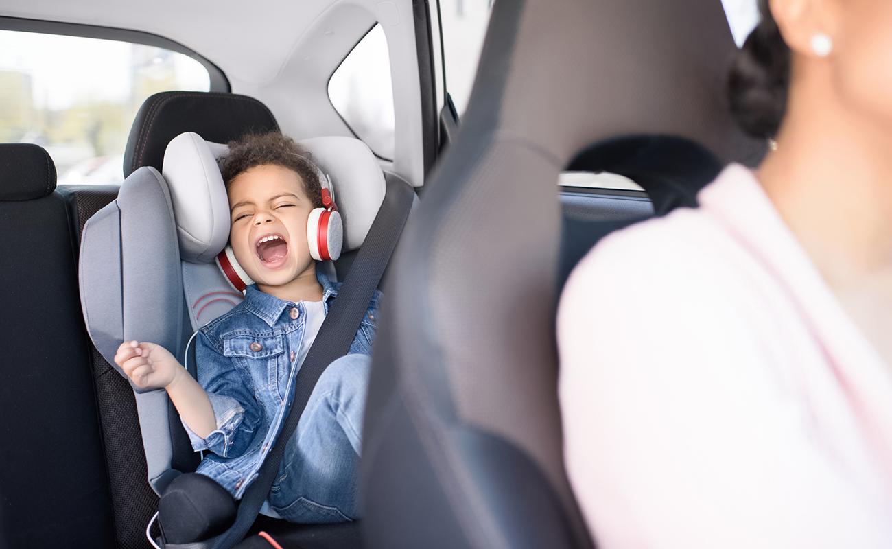 Child in backset of car throwing a tantrum